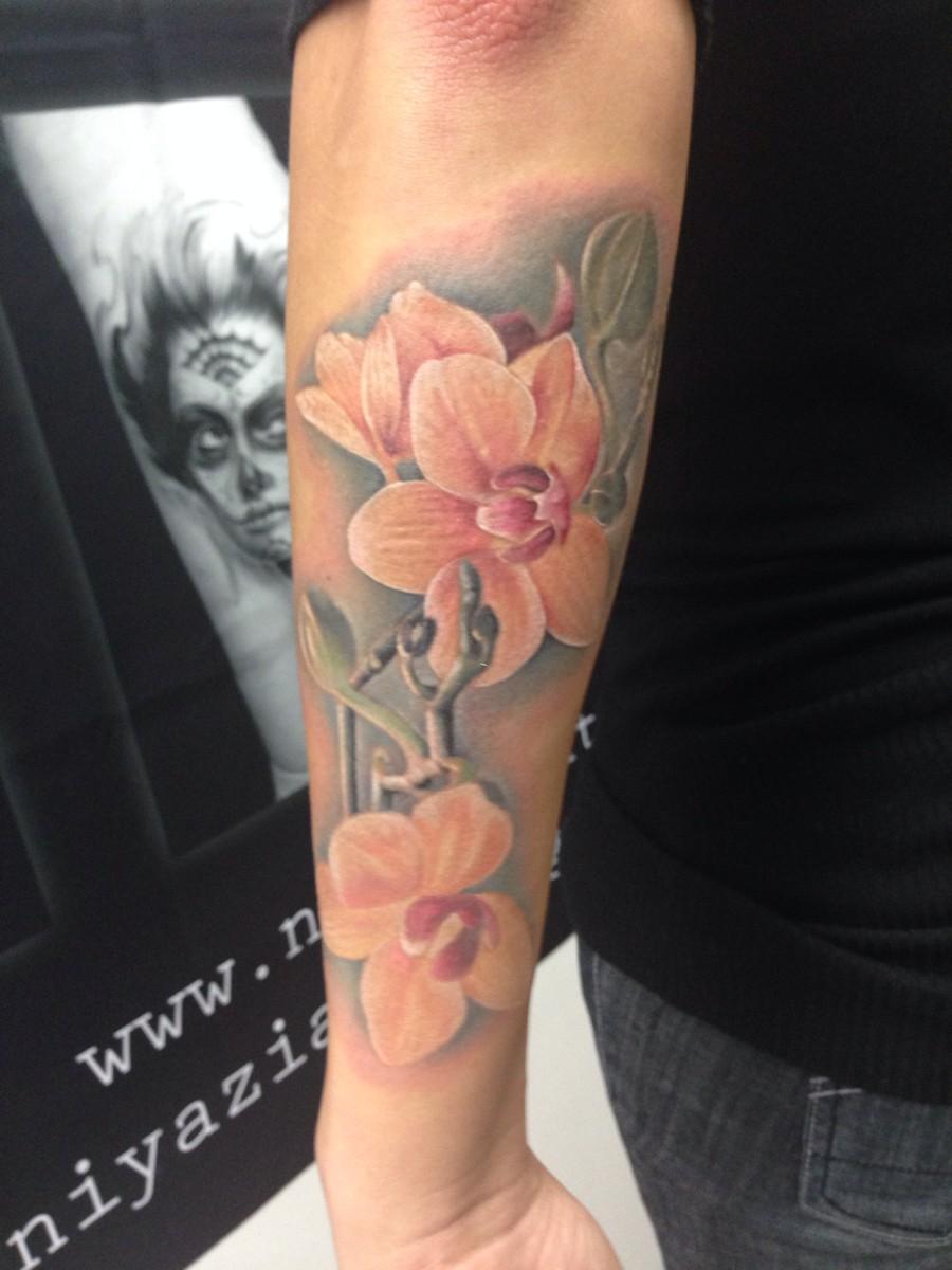 Татуировка орхидея у парней